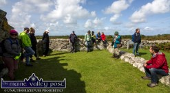 OPW Tour Guide, Michael Houlihan out on Scattery Island with his multi-national gathering on Wednesday. ©Photograph: John Reidy