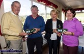 Castleisland Members' Golf Club weekly scramble organiser, Cyril Quigley (left) presenting a prize to Willie O'Sullivan while Lady captain, Maryann Downes makes a similar presentation to winner, Mary O'Sullivan after the final competitive event of the series on Wednesday. Photo by John Reidy