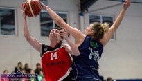Clash of the top scorers: Team Tom McCarthy's St. Mary's Lorraine Scanlon going for the basket with a determined challenge by Phoenix Rockets Amanda Fioravanti during Saturday night's game. ©Photograph: John Reidy