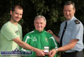 Local soccer coach, Georgie O'Callaghan (centre) receiving a presentation from Robbie Fields, KDYS and Sgt. John O'Mahony in recognition of his behind the scenes work in facilitating the annual KDYS /Garda Soccer League. ©Photograph: John Reidy 7-7-2010