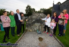 Members of the Shanahan family at the tomb of generations of their ancestors during the Ecumenical Service and Blessing of Graves at St. Stephen's Churchyard on Tuesday evening. Included are from left: Frances, Eliza and Jack Shanahan, Margaret Durkin, Margaret Geaney, Mia Smyth and Deirdre Shanahan, Aaron O'Mahony and Catherine Shanahan. ©Photograph: John Reidy