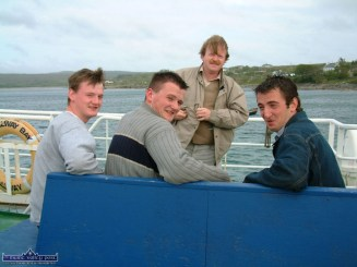 The late Mike Kenny pictured with the O'Connor brothers, Jerry and Joe and their cousin Philip on the ferry to Inishbofin. Photograph: John Reidy 6-6-2003