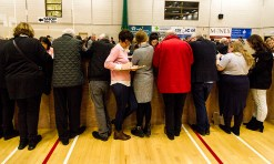 Tally - Ho: The boxes are opened and the tally people get down to work in one of the most anticipated general elections in years at the Kerry constituency count at Killarney Sports and Leisure Centre on Sunday morning. ©Photograph: John Reidy