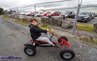 Castleisland lad, Ché O'Neill took his kart on a drive by the Drive-in-Bingo session on the yard of the Castleisland Co-Op Mart on Sunday afternoon. ©Photograph: John Reidy