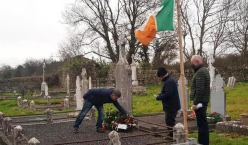 Author, Tim Horgan placing a wreath on Captain James Hickey's grave during the centenery ceremony at Dysary Cemetery with Éamonn Ó Braoin, MC and the late patriot's grandnephew, Tom Browne on St. Stephen's Day.