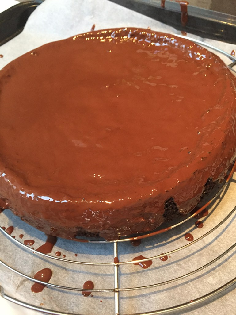 chocolate cake with coconut and a chocolate olive oil glaze