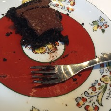 Half eaten serving of chocolate cake with coconut, it's that good