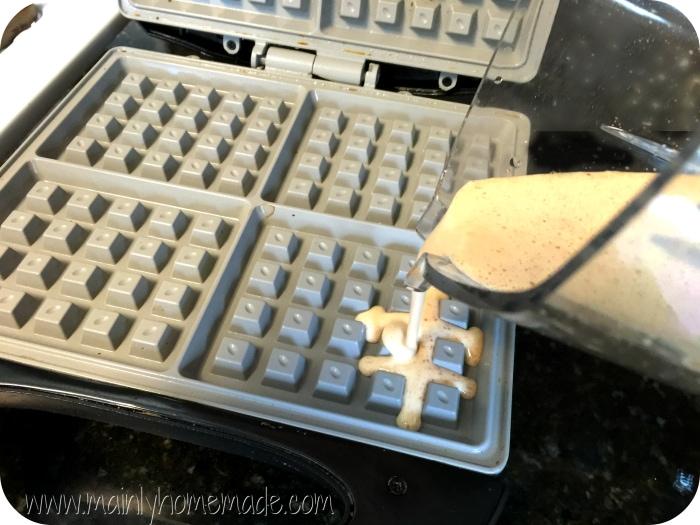 Pouring gluten free waffle recipe