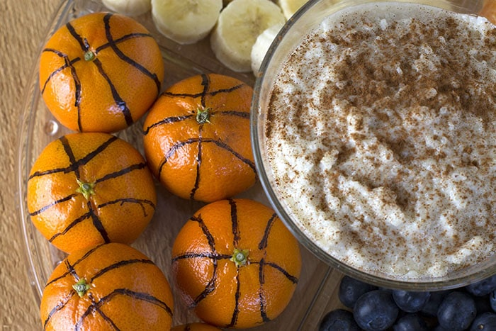Rice pudding dip with fruit and oranges