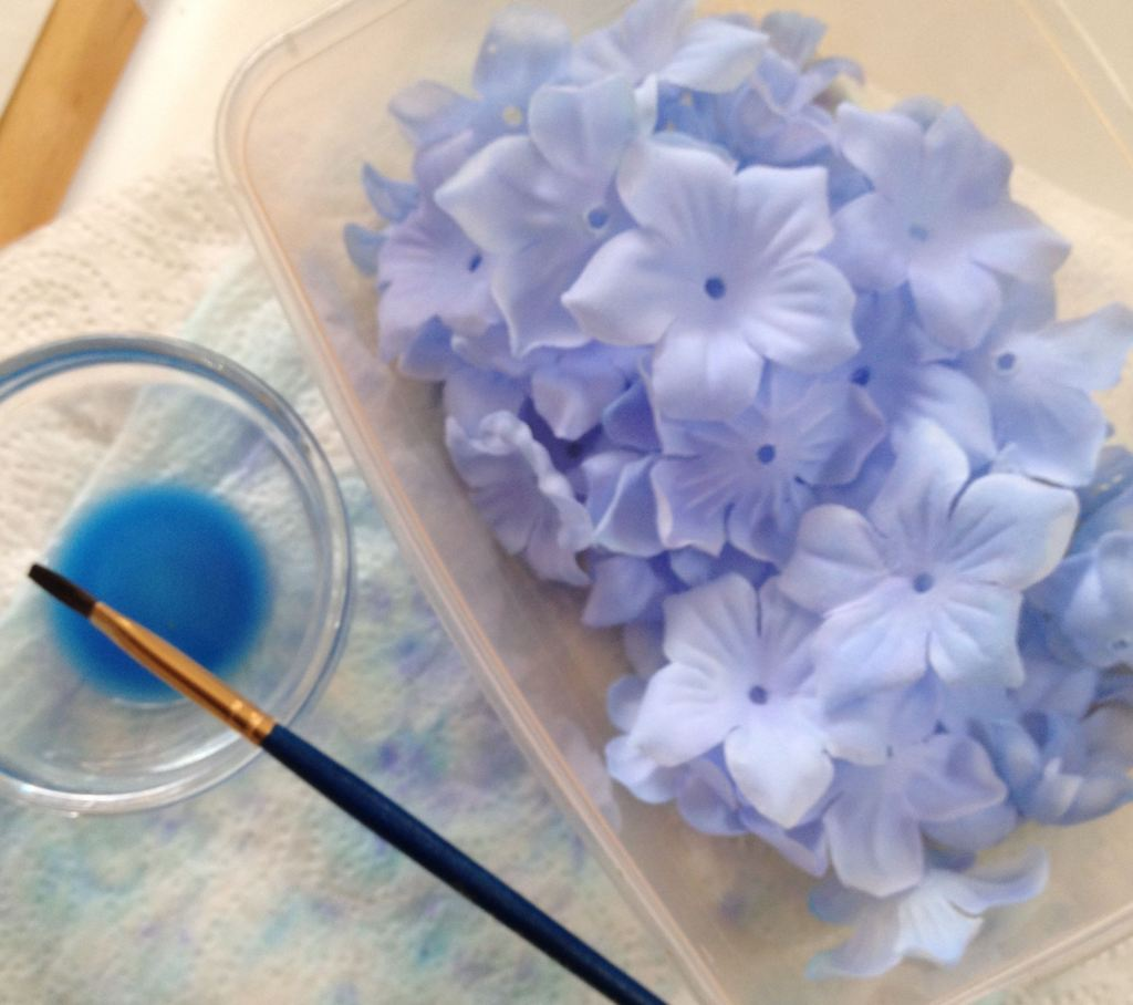 Silk flowers being hand dyed to match colour scheme