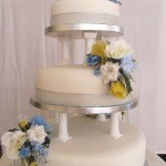 Blue and yellow silk wedding cake flowers