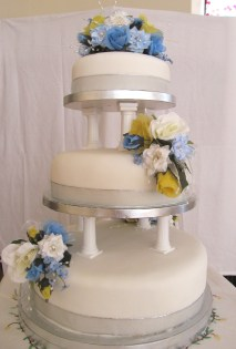 Blue and yellow silk wedding cake flowers