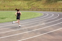 stockvault-a-cute-young-girl-running-on-a-track159205