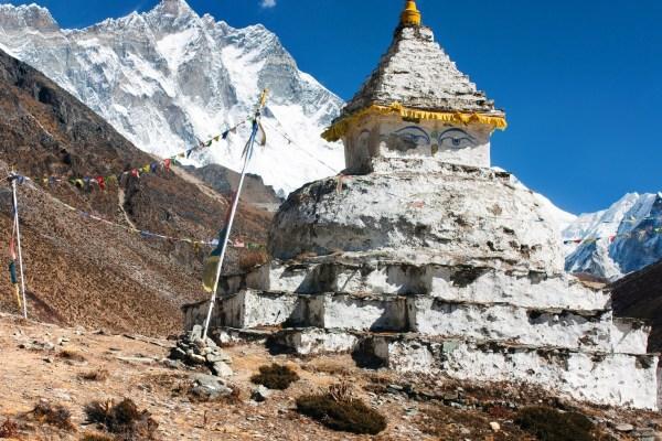 buddhist stupa with mount Lhotse - way to everest base camp