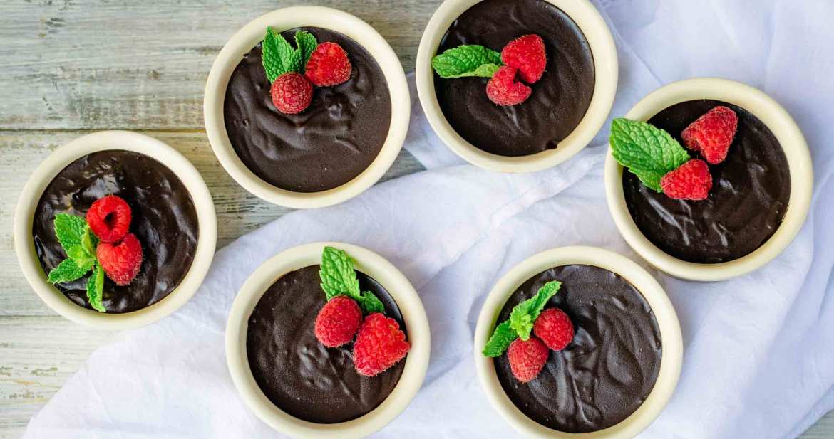 a group of homemade chocolate pudding cups makes for an elegant dessert display