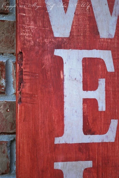 Make a custom wood sign look worn