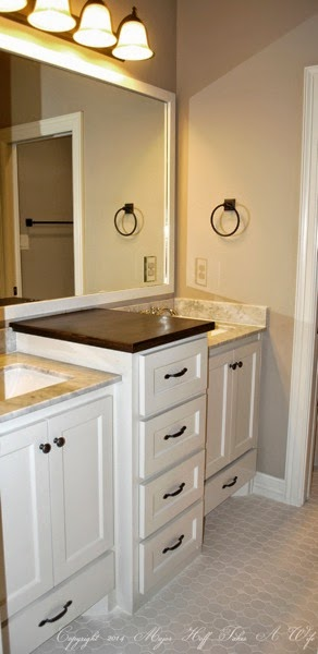Secondary bath with hexagon tile and double vanity