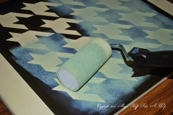 Using a tulip stencil roller brush to make artwork