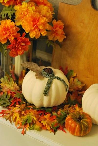 Painted Dollar Tree pumpkins with burlap leaves