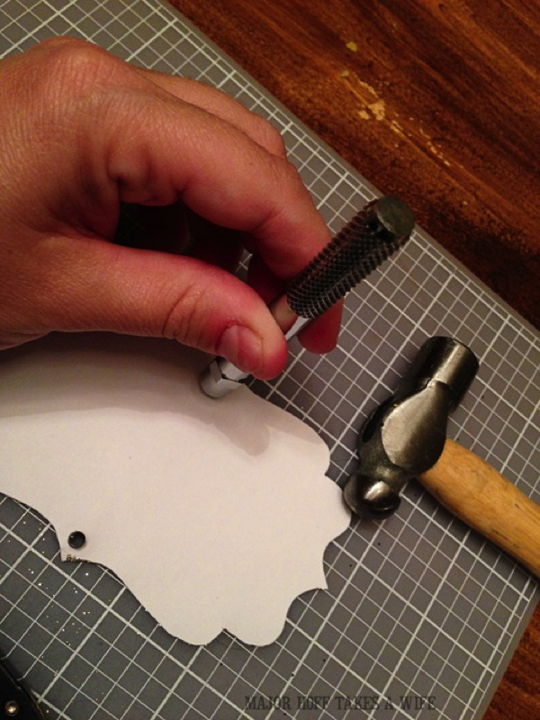 Using the craft tool to inset and attach a grommet to paper