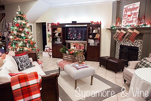 Christmas decorations in a living room for a plaid country Christmas.