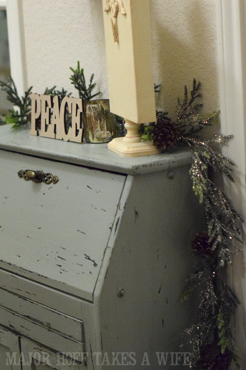 Entry way secretary desk decorated for Christmas