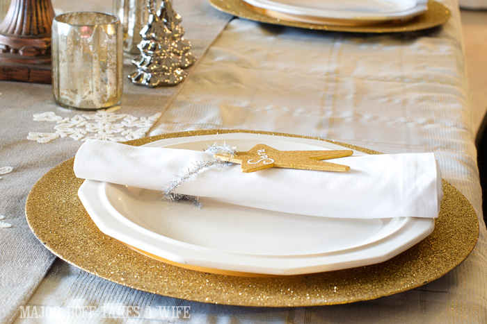 Gold White silver and mecury glass Christmas tablescape. A delightful Dining Room Holiday Tour. See how Mrs Major Hoff decorates for Christmas. The tour features table decorations, dining room decorating ideas, place settings and an idea for  homemade Christmas gift that can be personalized for your holiday guests. This post is part of the Home For The Holidays Blog Tour.