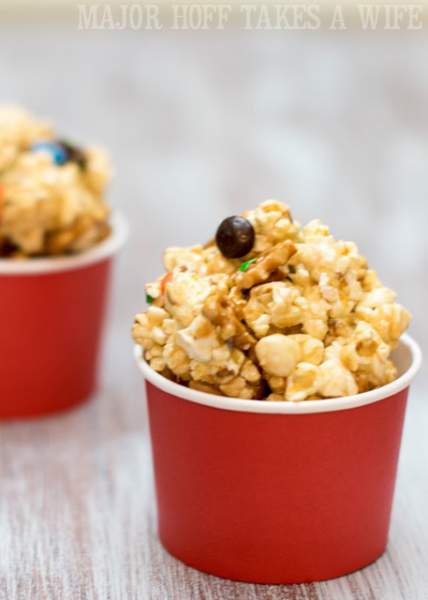 Movie Munch Snack mix in small containers. It's time for a Family Movie Night! You won't want to miss this recipe for the fabulous Movie Munch! Can you guess what the secret ingredient is? Post also shows how to create your own Guardians of the Galaxy Gift Basket, perfect for your favorite super hero fans, or for a Finals Survival kit. #OwnTheGalaxy #CBias #sp #ad
