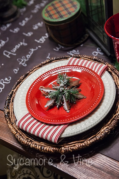 Plaid Country Christmas Table setting with greenery