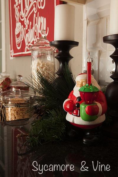 Vintage santa holding Christmas Bubble Light.
