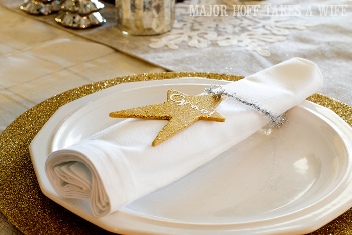 Place settings. A delightful Dining Room Holiday Tour. See how Mrs Major Hoff decorates for Christmas. The tour features table decorations, dining room decorating ideas, place settings and an idea for homemade Christmas gift that can be personalized for your holiday guests. This post is part of the Home For The Holidays Blog Tour.