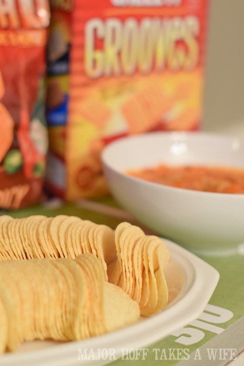 Pringles make a great party food. An easy to throw party for the Big Game. Features easy party ideas for snacks, dips and decor. Includes a recipe for Roasted Red Pepper Hummus without seeds! #BigGameSnacks #collectiveBias #ad