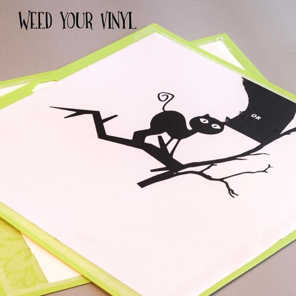 Weeding Vinyl on a Halloween black cat svg file