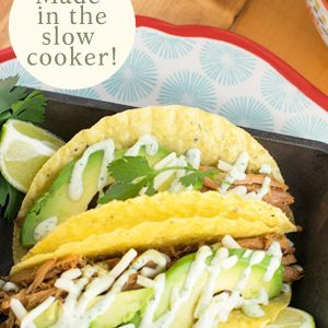 These easy pork tacos will knock your socks off! Make those hectic back to school dinners even easier by utilizing your slow cooker for this recipe. Features an additional recipe for Cilantro Aioli that makes the tacos taste like you just ordered them from a taco truck! So grab your crockpot and let's get Taco Tuesday going! #porkrecipe #crockpot #taco