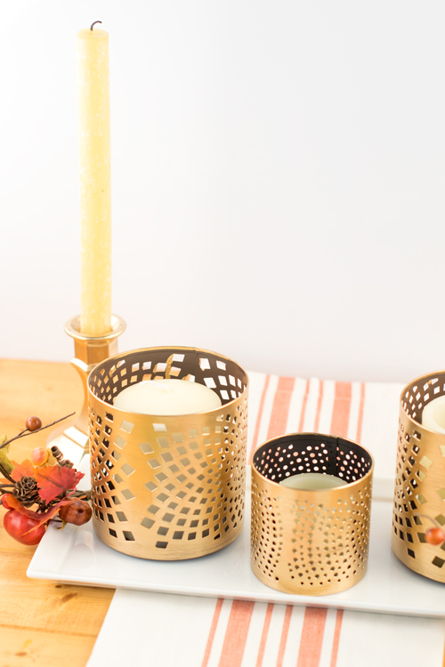 Shiny gold candlestick holders