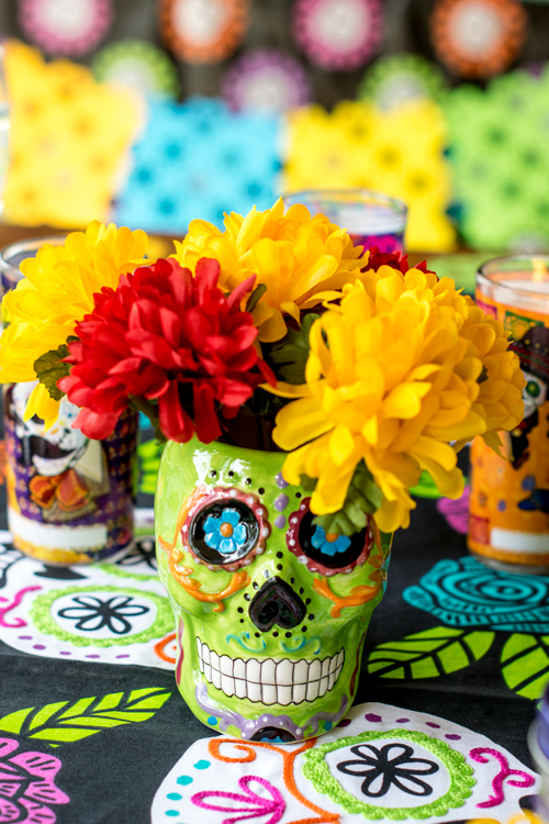 Sugar skull coffee mug filled with marigolds