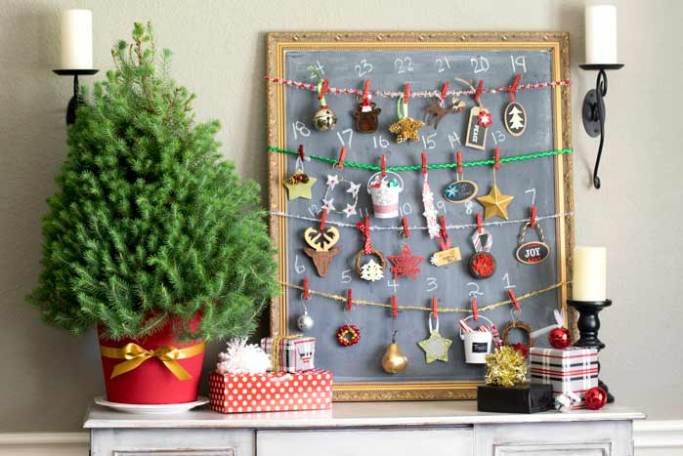 A dining room buffet features a handmade advent calendar using a mini Christmas tree and 24 ornaments