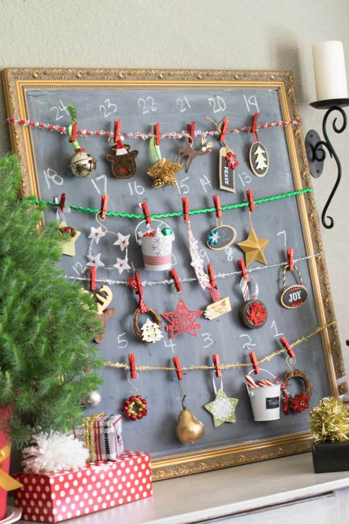 24 Christmas ornaments hang from a numbered chalkboard for a fun advent countdown.