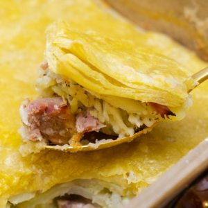 layers of ham potatoes and sauce for a quick weeknight comfort food dish