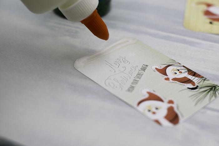 Glue prep for glittering secret santa gift tags