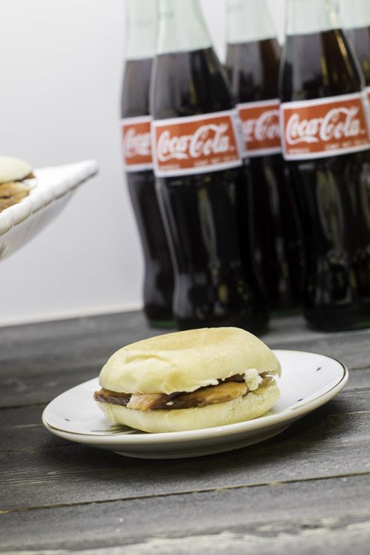 Serve coke with sandwiches