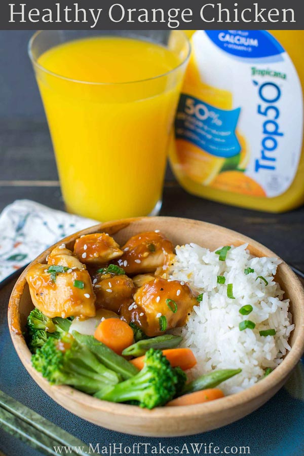 This skinny orange chicken recipe will be a new favorite! This healthy and hearty meal whips up in under 30 minutes. Inspired by your favorite Chinese restaurants, it features crispy chicken and vegetables sautéed in the skillet and topped with a gluten free sauce. A terrific weeknight stir fry dish! #orangechicken #glutenfree #fastdinner via @mrsmajorhoff