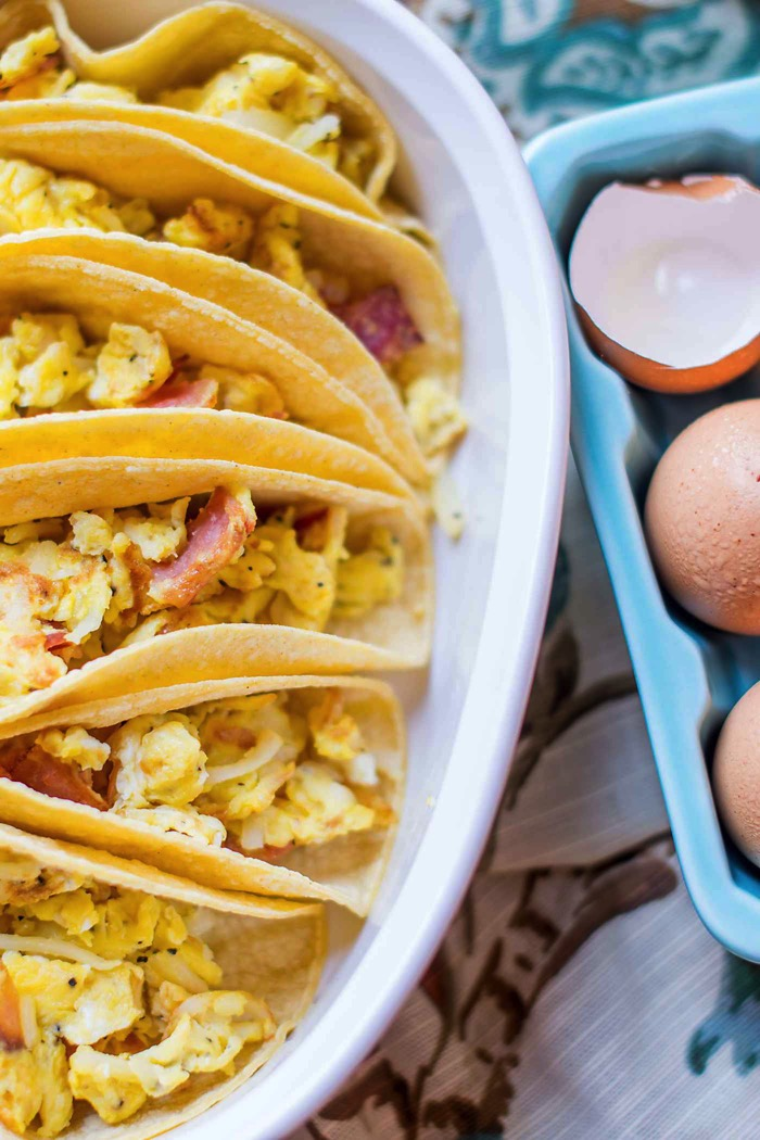 Breakfast Tacos For A Crowd! An easy way to feed a bunch at your next brunch! You'll love this mix of eggs, potatoes, bacon and cheese! So easy! via @mrsmajorhoff