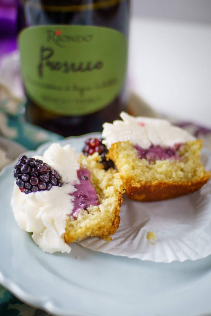 Blackberry compote stuffs cupcakes made with Prosecco sparkling wine