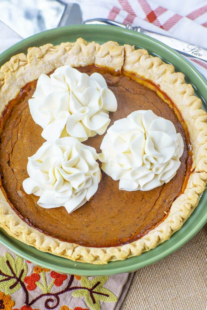 molasses pumpkin pie with homemade stable whipped cream flower shapes