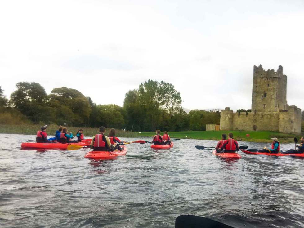 Kayaking next to Ross Castle in Ireland