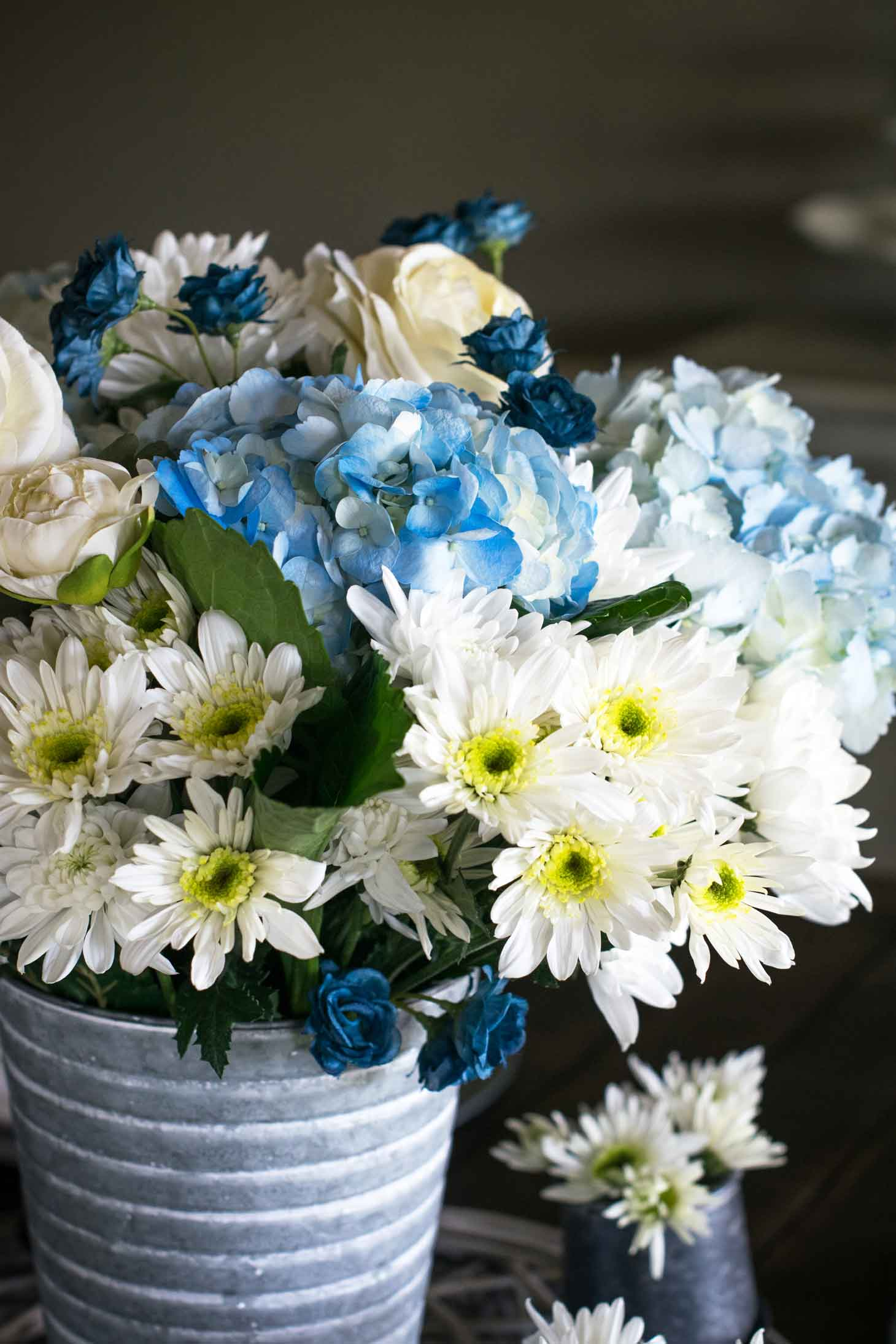 blue and white hydrangea, Euro pops, and more for a spring floral centerpiece