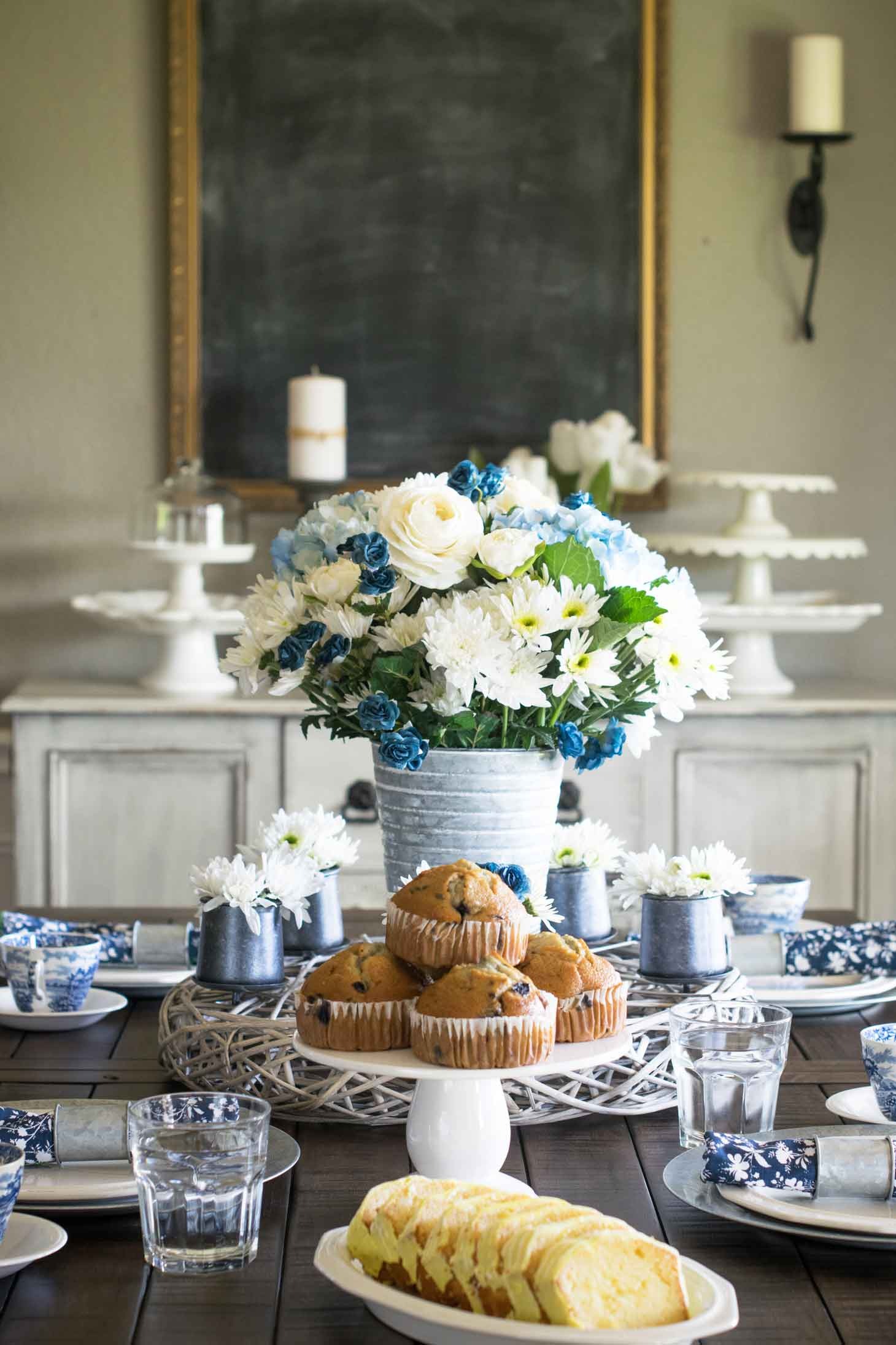 This blue and white china spring tablescape is sure to wow your guests on Easter and beyond. It utilizes antique blue and white antique ironstone as well as modern napkins and a fresh floral centerpiece. via @mrsmajorhoff