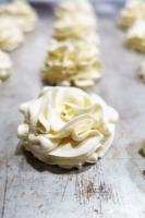 ruffly flowers made from whipped cream stabilized with gelatin and piped with oversized piping tips