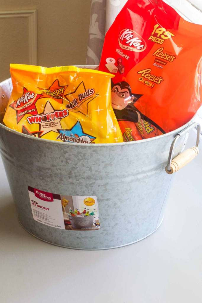 Start with a plain bucket to cover with Vinyl cut from SVG files for a Halloween candy holder